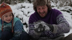 Portrait of a father and sons playing snowballs. Stock Footage