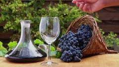 Wine is poured into a glass carafe Stock Footage