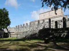 Mexico Chichen Itza court columns ruins man DCI 4K Stock Footage