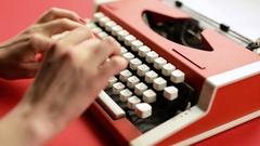 Woman hand typing on red vintage typewriter Stock Footage