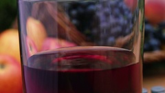 Drop dripping into a glass of wine Stock Footage