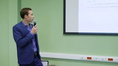 Business school student speaks at a seminar for finance. Young man uses a Stock Footage