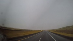 "Wide Angle POV Driving Shot -  ""Atlas Van Lines"" pass Wyoming, USA in Winter Stock Footage"