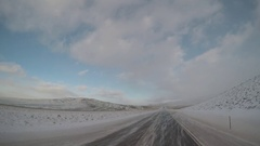 Wide Angle POV Driving Shot -  A Semi-Truck Passes in Wyoming, USA in Winter Stock Footage