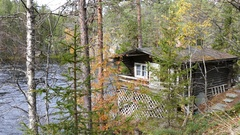 Wooden house next to a river in the forest of Oulanka National Park Stock Footage