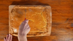 Woman cutting homemade pie with meat and herbs Stock Footage