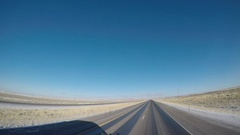 Wide Angle POV Driving Shot -  A Semi-Truck Casts a Shadow in Wyoming, USA\ Stock Footage