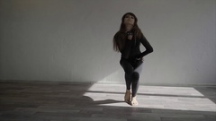 Beautiful, modern teenage girl dancer dancing contemp in the studio slow motion Stock Footage