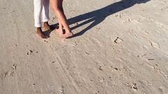 Loving couple feet are in the sand Stock Footage