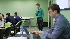 Male student in classroom having an examination at the university. Young Arkistovideo