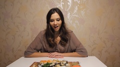 Young attractive woman delighted by sushi Stock Footage
