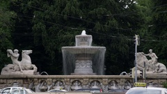 Fontaine in Munich with road traffic Stock Footage