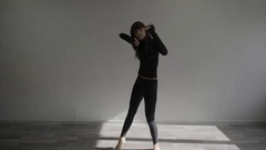Young woman dancer dancing contemp moves in the studio slow motion Stock Footage