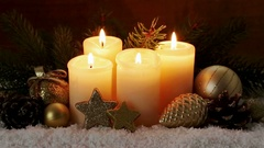 Four burning advent candles and Christmas decoration. Stock Footage