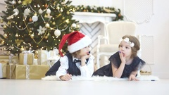 Children write letters to Santa Claus. To children it is cheerful. Stock Footage