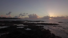 Black stones and coast in Mauritius at sunset, aerial view Stock Footage