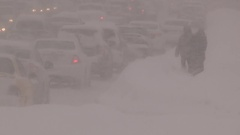 Blizzard conditions in the city during snowsquall Stock Footage