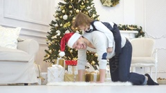 The father plays with children near the Christmas tree. Stock Footage
