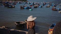 Beautiful woman see on Traditional fishing boat on small waves. Vietnam hd Stock Footage