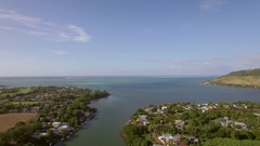 Coastal town and river falling into ocean. Mauritius aerial view Stock Footage