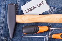 Labor Day card and instruments. Stock Photos