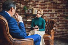 Attentive psychologist listening to patient Stock Photos