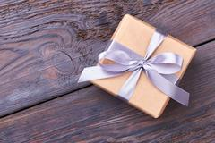 Wrapped gift box with bow. Stock Photos