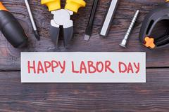 Tools and Labor Day card. Stock Photos