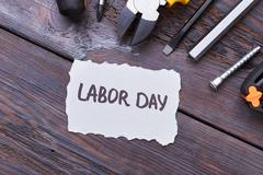 Labor Day card on wood. Stock Photos