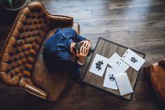 Man bowing his head in desperation Stock Photos