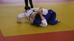 Winning IPPON judoka woman athlete Stock Footage