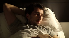 Man can't sleep and gets up from bed Closeup of person getting up from bed Stock Footage