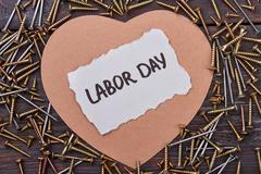 Labor Day card and screws. Stock Photos