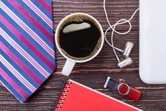 Coffee, flash drive and earphones. Stock Photos