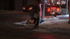 Homeless person sleeping on the street downtown at night Stock Footage