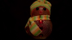 Christmas toy snowman shimmers in different colors Stock Footage
