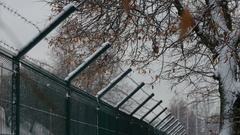 Barbed wire fence in winter Stock Footage