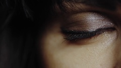 Close up macro shot of young woman's green eye with make up open Stock Footage