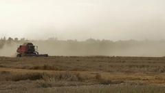 Lithuania, Ukmerges region. Harvester machine to harvest wheat Stock Footage