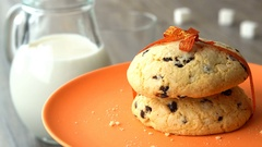 Delicious sweet chocolate-chips cookies with an orange ribbon. Milk-jug, on Stock Footage