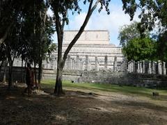 Mexico Chichen Itza ruins couple columns jungle DCI 4K Stock Footage