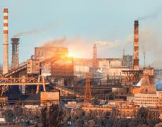 Metallurgical plant at colorful sunset. Industrial landscape. Steel factory Kuvituskuvat