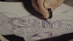 Tattoo master drawing sketch close up Stock Footage