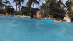 Little girl practise swimming on the pool, Stock Footage