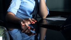 Bored businesswoman tapping fingers and waiting in office sitting by glass table Stock Footage