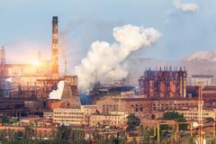 Metallurgy plant in Ukraine at sunset. Steel factory with smog Kuvituskuvat