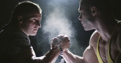 Two strong mans armwrestling in atheletic common-room Stock Footage