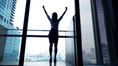 Successful businesswoman raising arms, power symbol, super slow motion 240fps Stock Footage