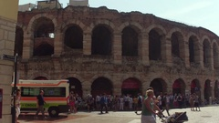 VERONA, ITALY - Sept 12, 2016: Tourists and ambulance near Verona Arena Roman Stock Footage