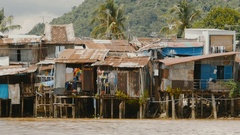 Slums in Nha Trang. Houses on the river Stock Footage